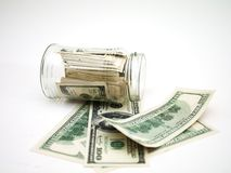 Dollars in money jar Stock Photo