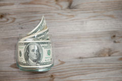 Dollars in money jar. Royalty Free Stock Photo