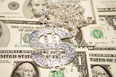 Dollars and necklace. A background of dollar bills and a diamond necklace Royalty Free Stock Photo