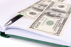 Dollars on the notebook Stock Image