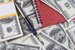 Dollars, notebook and pen Stock Photo