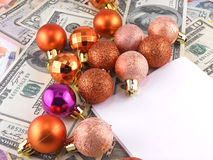 Dollars notes with christmas balls on it Royalty Free Stock Photo