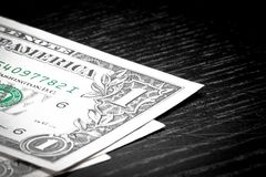 Dollars on old black wood Royalty Free Stock Images