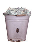 Dollars in old rusty bucket Stock Image