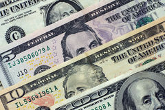Dollars. One hundred dollars, ten dollars, five dollars and one dollar. Closeup Royalty Free Stock Images