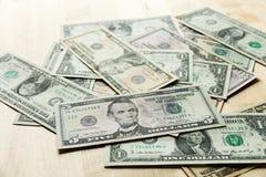 dollars op de lijst Stock Afbeeldingen