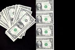 Dollars op een zwarte achtergrond Stock Afbeeldingen