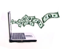 Dollars out of laptop Stock Images