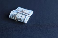 Dollars in a pack. On a blue background Stock Image