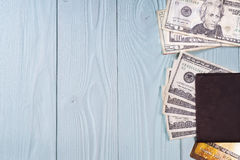 Dollars, passport, credit cards on a blue wooden background. Stock Photos