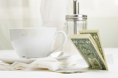 Dollars in payment for coffee Royalty Free Stock Photo