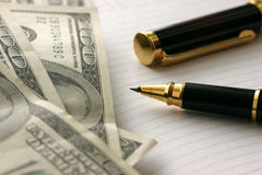 Dollars and pen. Dollars, notebook and pen Stock Photography