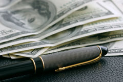 Dollars and pen. Money and pen Stock Images