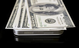 Dollars on phone. Money  lie on the phone Royalty Free Stock Images