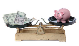 Dollars and piggy bank Stock Images