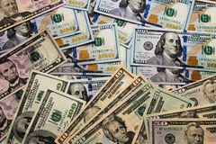 Dollars pile as background. A pile of US banknotes. royalty free stock images