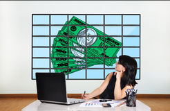 Dollars on plasma panel Stock Photos