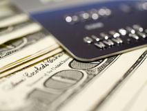 Dollars and plastic card. Royalty Free Stock Photos