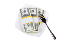 Dollars on  a plate with a fork Royalty Free Stock Photos