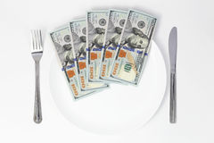 Dollars on plate Royalty Free Stock Images