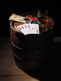 Dollars and playing cards on a wooden barrel Royalty Free Stock Photo