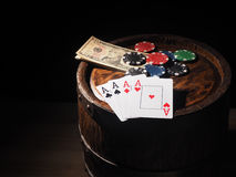 Dollars and playing cards on a wooden barrel Royalty Free Stock Photos