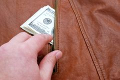 Dollars in a pocket Royalty Free Stock Images