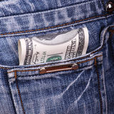 Dollars in a pocket. Dollars in a jeans pocket Royalty Free Stock Photo