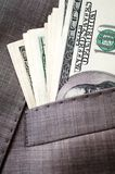 Dollars in the pocket of business suit Royalty Free Stock Photos