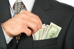 Dollars in pocket of coat and hand Royalty Free Stock Images