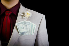 Dollars in the pocket of the groom's wedding suit Royalty Free Stock Image