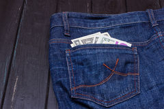 Dollars in a pocket of jeans. Some dollars in a pocket of jeans Royalty Free Stock Photography