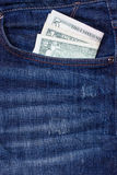 Dollars in a pocket of jeans. Some dollars in a pocket of jeans stock images