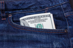 Dollars in a pocket of jeans Royalty Free Stock Photos