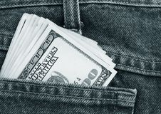 Dollars in a pocket. Lot of dollars in a pocket of jeans Stock Images
