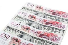 Dollars and pounds Stock Images