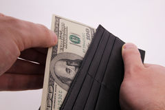 Dollars in the purce Stock Images