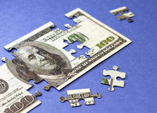 Dollars puzzle. Concept of finance and savings Royalty Free Stock Photos