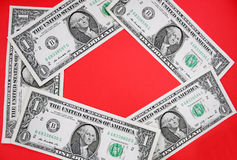 Dollars on red backgroudn. Royalty Free Stock Photography