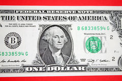 Dollars on red backgroudn. Stock Image