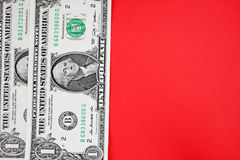 Dollars on red backgroudn. Royalty Free Stock Images