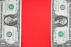 Dollars on red backgroudn. Stock Photo