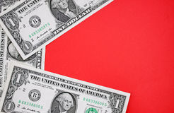 Dollars on red backgroudn. Royalty Free Stock Photo