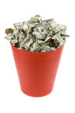 Dollars in Red Garbage Can. With White Background stock photography
