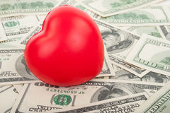 Dollars and red  heart Royalty Free Stock Photo