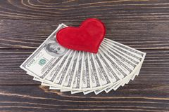 Dollars and red heart Stock Image