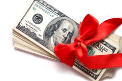 Dollars with red ribbon isolated on white Stock Photo