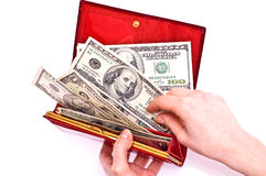 Dollars and red wallet Royalty Free Stock Photos
