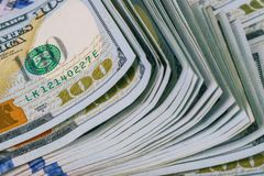 Dollars rolled closeup. American Dollars Cash Money. One Hundred Dollar Banknotes. Lots of dollar bank notes on the table Royalty Free Stock Photography
