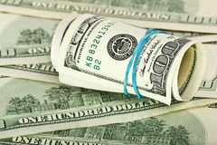Dollars rolled into a tube Royalty Free Stock Photo